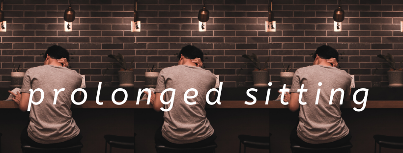 Image of a man slouched at a bar table